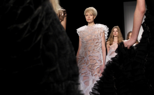 Models present a creation at Berlin Fashion Week