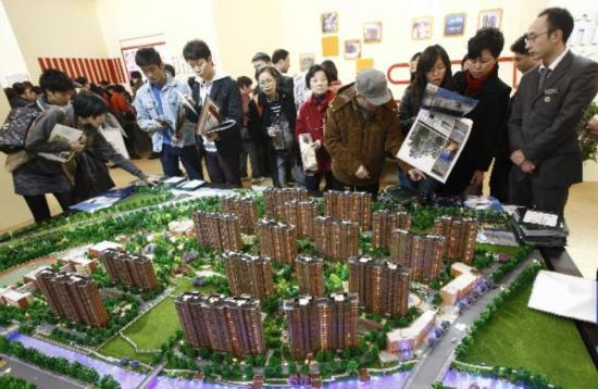 China's Chongqing, Shanghai launch property tax to cool housing market
