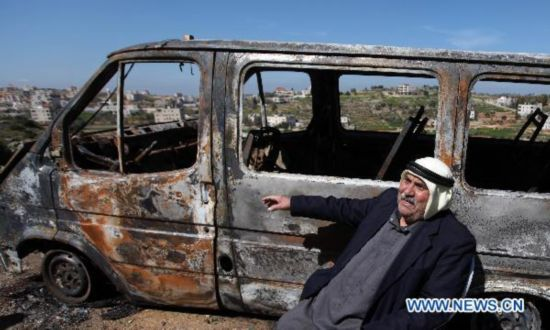 Cars burned by Jewish settlers in the West Bank