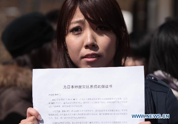 Students of Tsinghua University donate for quake-hit Japan