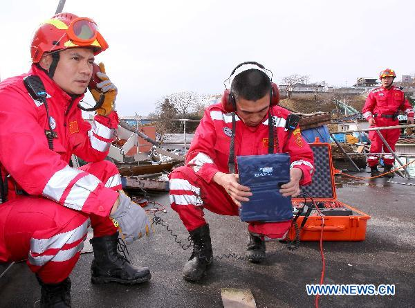 Chinese rescue team continues relief work in Japan quake zone