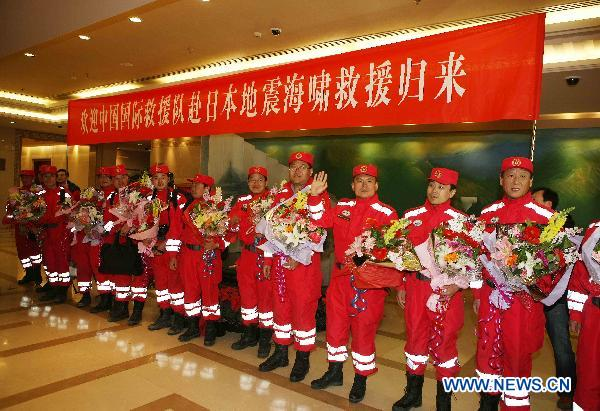 Chinese rescue team returns from Japan