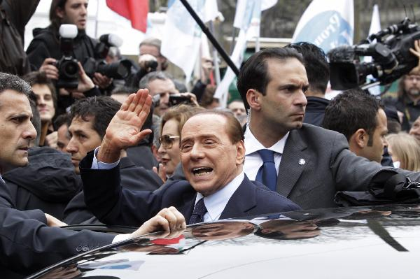 Italy's Berlusconi makes rare court appearance in Milan