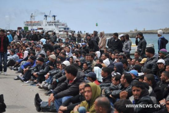Immigrants from North Africa wait for transfer at Lampedusa