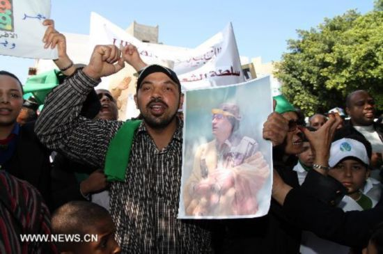 Supporters of Libyan leader Gaddafi protest outside UN offices