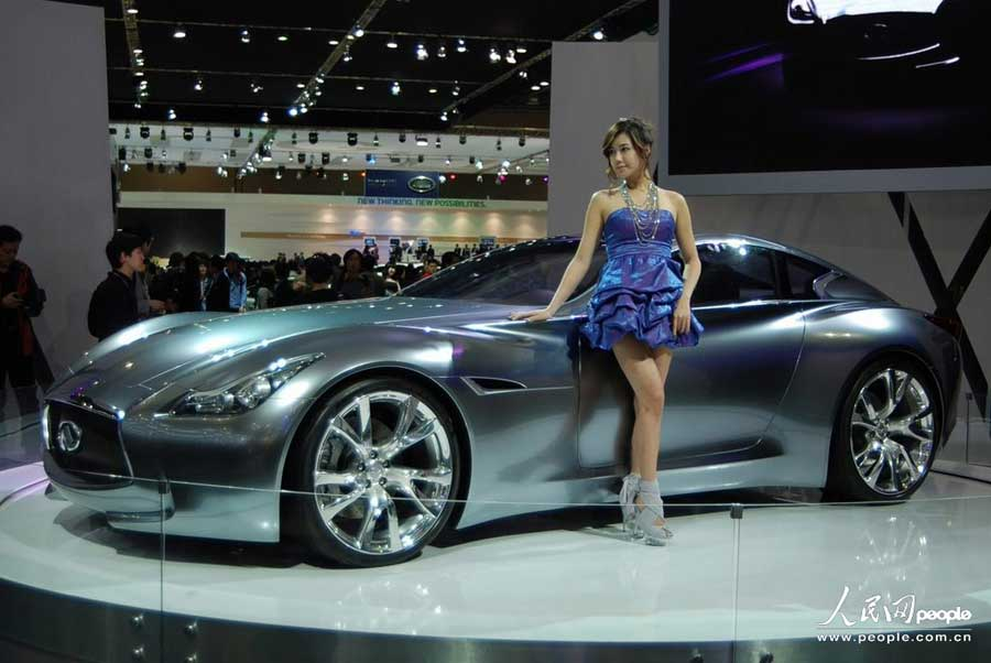 """A model displays a car at the 2011 Seoul Motor Show held in South Korea on April 6, 2011. The 2011 Seoul Motor Show with the theme of """"Evolution, ..."""