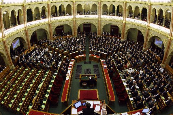 Hungarian parliament adopts new constitution despite protests, opposition boycotts