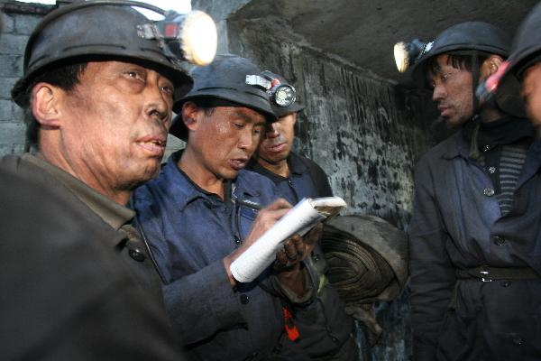 Rescuers striving to retrieve flood-trapped coal miners in SW China