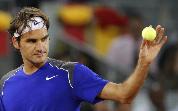 Federer, Nadal advance at Madrid Open, Sharapova out