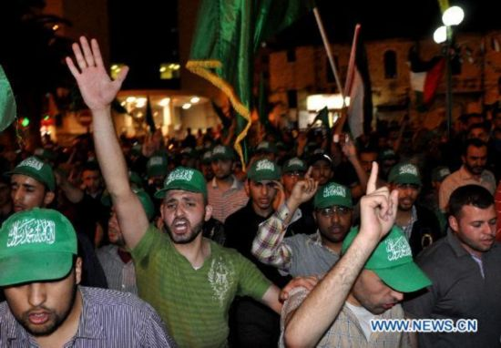 Palestinian supporters of Hamas celebrate reconciliation deal