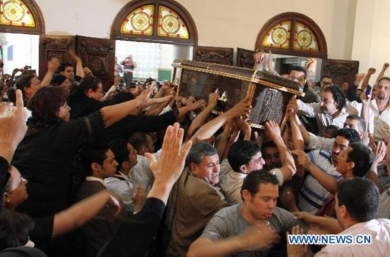Funeral held for victims in Cairo's Coptic church clashes