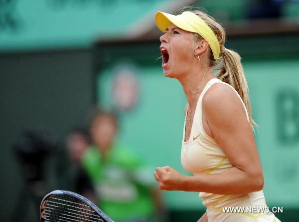 Sharapova fights back to win second match at French Open