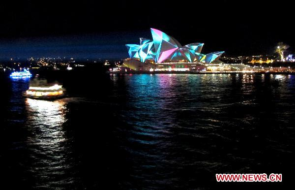 Vivid Sydney festival begins with Opera House glowing