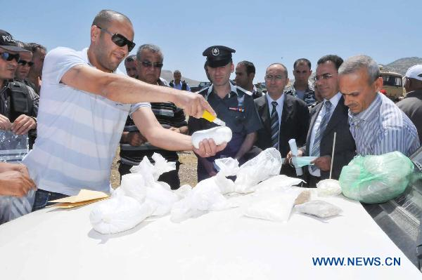 Lebanese security forces destroy confiscated drugs