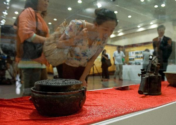 Exhibition showing relic from Zhongshan Warship opens in HK