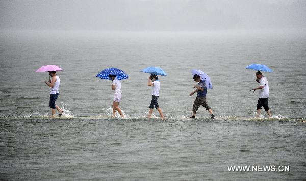 Wuhan waterlogged by torrential rains