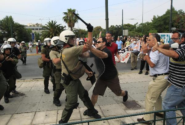 Greek parliament approves austerity measures amid protests