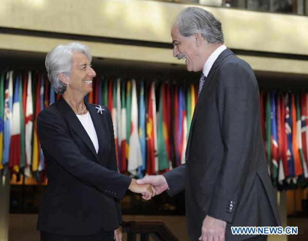 Lagarde takes over as IMF chief