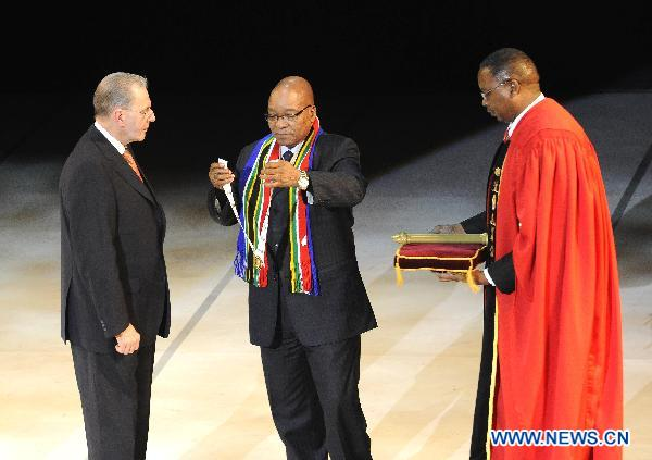 South African president honors Olympic chief