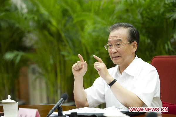 Chinese premier urges cooling prices, avoiding growth fluctuations