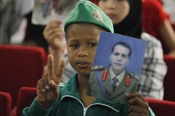 Children hold rally to support Gaddafi in Tripoli, Libya