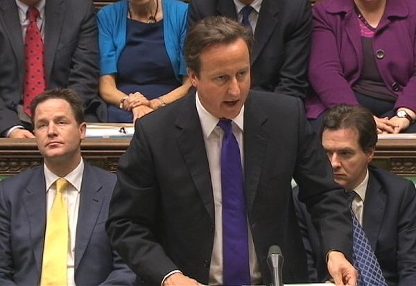 Cameron names investigation panel on phone hacking scandal