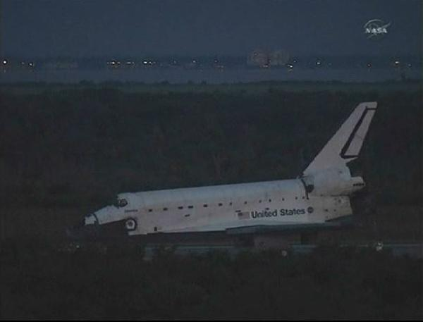 Atlantis lands at Kennedy Space Center, ending U.S. shuttle program