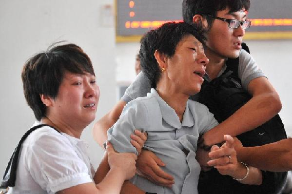 Relatives mourn train crash victims