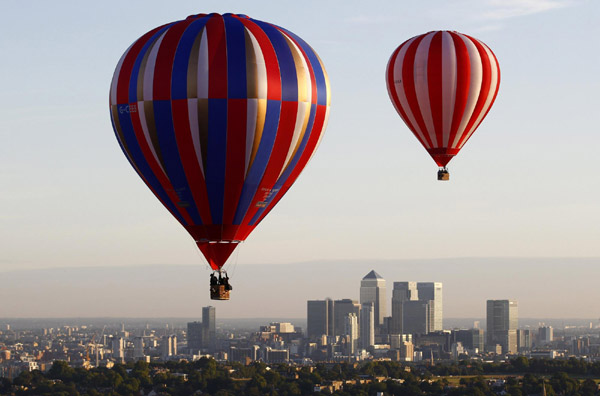 Hot air balloons rise over London