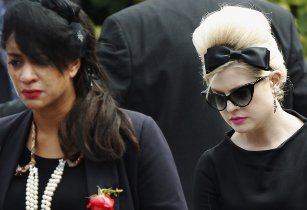 Kelly Osbourne attends Winehouse's funeral