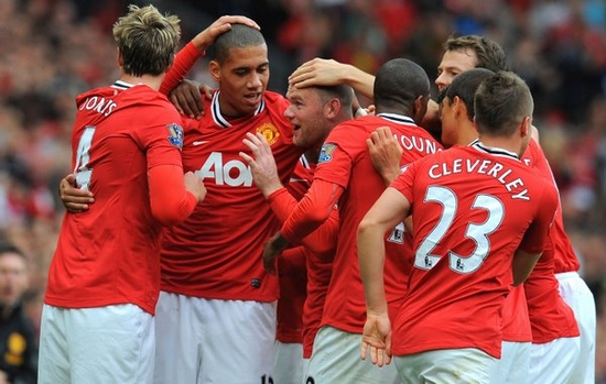 Manchester United's English striker Wayne Rooney (3rd L) celebrates with team-mates after scoring during the English Premier League football match between Manchester United and Arsenal at Old Trafford in Manchester, north-west England on August 28, 2011. Manchester United won the game 8-2. (Xinhua/AFP)