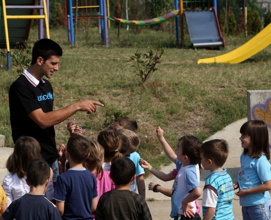 "ATP top 1 and UNICEF National Ambassador for Serbia Novak Djokovic plays with children at kindergarten ""Brownie"" in Smederevo, central Serbia, on Sept. 26, 2011. The kindergarten is specialized for children with disabilities and refugees. Djokovic was appointed as a UNICEF National Ambassador for Serbia last August. (Xinhua/Vladimir Gogic)"
