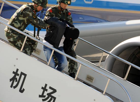 The photo, taken on Sept. 26, shows the armed policemen taking a terrorist off the plane. (Xinhua/Wangkai)