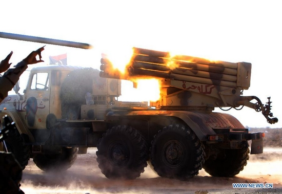 Forces of the Libyan National Transitional Council (NTC) fire rockets to the fighters loyal to Muammar Gaddafi outside the city of Bani Walid, Libya, Sept. 27, 2011. Bani Walid is still occupied by fighters loyal to Muammar Gaddafi. (Xinhua/Hamza Turkia)