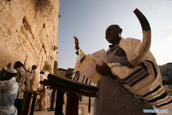 Jewish worshippers pray at the Western Wall, Judaism's holiest prayer site, in Jerusalem's Old City on Sept. 28, 2011, ahead of Rosh Hashanah, the two-day Jewish new year which will begin at sunset on Sept. 28 and conclude at nightfall on Sept. 30. (Xinhua/Muammar Awad)