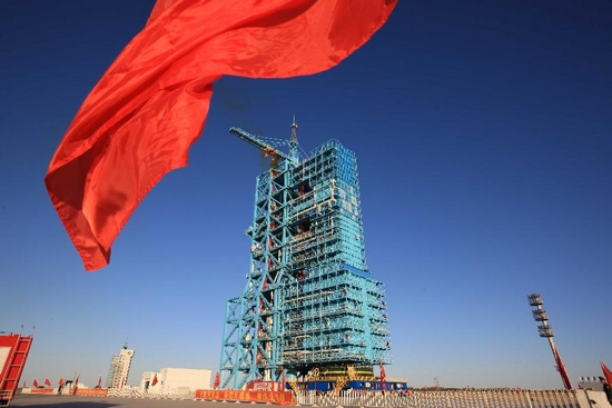 Red flag flies at the Jiuquan Satellite Launch Center in northwest China's Gansu Province, Sept. 28, 2011. A spokesperson with China's manned space program said Wednesday that fuel has been injected into the Long March-2FT1 carrier rocket in preparation for launching the Tiangong-1 space module Thursday evening as planned. (Xinhua/Wang Jianmin)