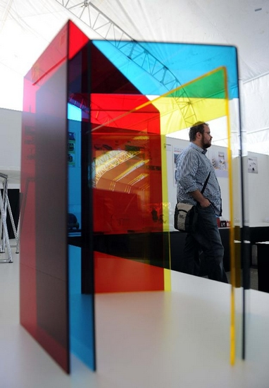 A visitor looks at the designing works in the exhibition of Istanbul design week on Sept. 28, 2011 in Istanbul, Turkey. Istanbul design week will be hosting designers and design exhibitions from around the world in Istanbul from Sept 28 to Oct 2 with the participation of 25 countries. (Xinhua/Ma yan)