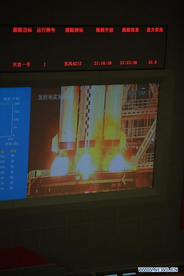 Image taken from Beijing Aerospace Control Center shows a Long March-2FT1 carrier rocket loaded with Tiangong-1 unmanned space lab module blasting off from the launch pad at the Jiuquan Satellite Launch Center in northwest China's Gansu Province, Sept. 29, 2011. (Xinhua)