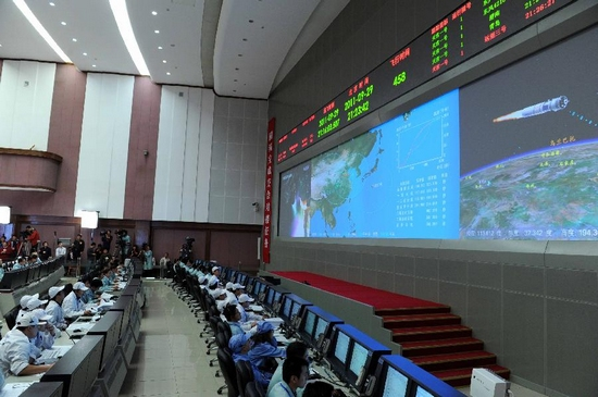 Staff members are in position at Beijing Aerospace Control Center in Beijing, capital of China, Sept. 29, 2011. Commander-in-chief of China's manned space program Chang Wanquan announced Thursday night that the launch of Tiangong-1 space lab module was successful. (Xinhua/Rao Aimin)