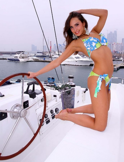 A winner of the 36th Miss Bikini International 2011 poses for a photo at the Olympic Sailing Center in Qingdao, a coastal city of east China's Shandong Province, Sept. 29, 2011. (Xinhua/Chen Jianli)