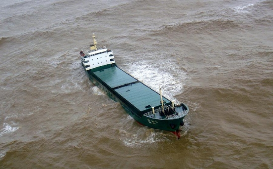 Photo taken on Sept. 29, 2011 shows a cargo ship in danger on the sea near Zhuhai City, south China's Guangdong Province. Cargo ship Fangzhou 6 of Qingzhou of southwest China's Guangxi Zhuang Autonomous Region lost control after water stormed into its cabin due to Typhoon Nesat on the sea near Zhuhai Thursday, leaving 12 crew members in danger. Rescuers rushed to the ship and saved them by using a helicopter. (Xinhua)