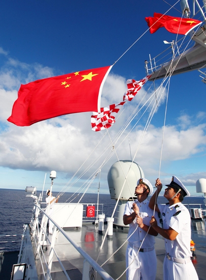 "Chinese Navy soldiers hold a national flag (L) raising ceremony marking the upcoming 62nd National Day aboard Chinese Navy hospital ship ""Peace Ark"" in the Pacific on Sept. 29, 2011. The Chinese National Day falls on Oct. 1. (Xinhua/Zha Chunming)"