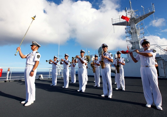"Chinese Navy soldiers hold a national flag raising ceremony marking the upcoming 62nd National Day aboard Chinese Navy hospital ship ""Peace Ark"" in the Pacific on Sept. 29, 2011. The Chinese National Day falls on Oct. 1. (Xinhua/Zha Chunming)"