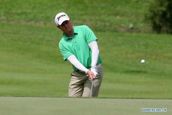 Paul Donahoo of Australia competes during the third round of The Asian Tour of ICTSI Philippine Open Golf Tournament in Mandaluyong City, Philippines, Feb. 11, 2012. The 300,000 USD Asian Tour tournament runs from Feb. 9 to 12. (Xinhua/Rouelle Umali)