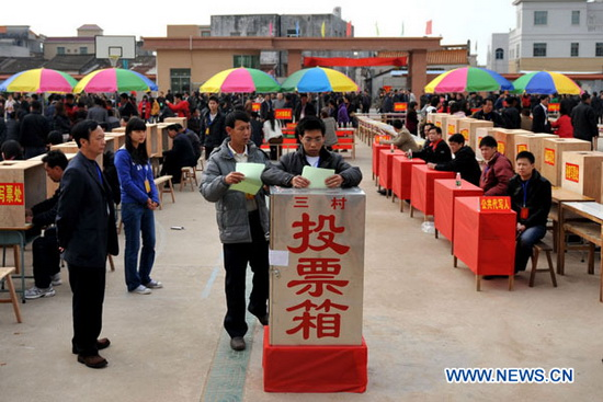 Villagers cast their ballots into a box while voting for deputies in Wukan Village, south China's Guangdong Province, Feb. 11, 2012. More than 6,000 villagers of Wukan, known for last year's protests over illegal land use and other issues, voted for deputies Saturday in the second round of democratic elections for new leadership. Their voting will result in a team of 107 village representatives and seven group leaders. Under the new village leadership, the deputies will attend village committee meetings, report the villagers' suggestions and complaints to the village committee and keep the villagers informed of decisions made at the deputies' meetings. (Xinhua/Lu Hanxin)