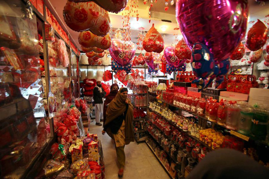 People are seen in a shop selling gifts for the upcoming Valentine's Day in northwest Pakistan's Peshawar on Feb. 11, 2012. (Xinhua/Umar Qayyum)