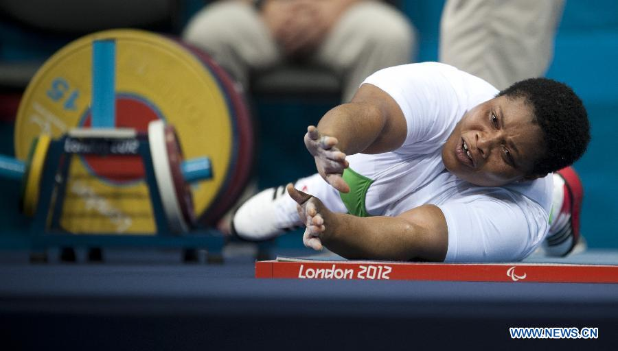 Loveline Obiji of Nigeria reacts after the Women's 82.50 kg powerlifting competition at the London 2012 Paralympic Games in London, Britain, on Sept. 4, 2012. Lovelin Obiji took the gold medal with 145 kg. (Xinhua/Lui Siu Wai)