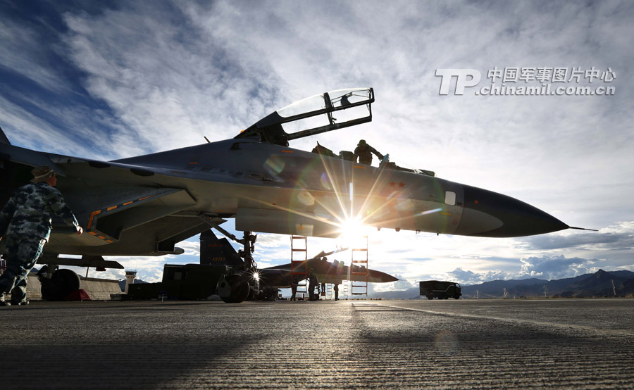 On the evening of August 27, 2012, an aviation division under the air force of the Chengdu Military Area Command (MAC) of the Chinese People's Liberation Army (PLA) organized night training at a military airport on the snow-capped plateau, which was the first successful plateau night training of the 3rd-generation fighters of the division. (China Military Online/Liu Yinghua)