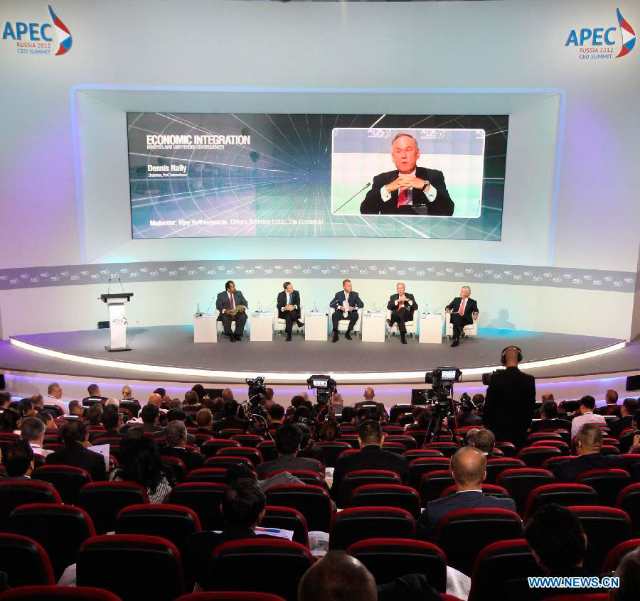 Dennis Nally (2nd R, back), chairman of global consulting firm PricewaterhouseCoopers (PwC) speaks at the APEC CEO summit in the Russian Far Eastern city of Vladivostok, Sept. 7, 2012. Over 300 CEOs of the business circles from around the Pacific rim gathered on Friday in Vladivostok for their 2012 summit held parallel to the annual APEC leaders' informal meeting. (Xinhua/Lu Jinbo)