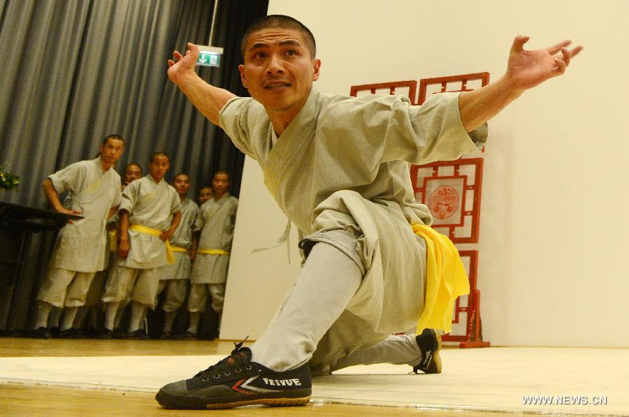 Disciples of China's famed Shaolin Temple perform at the opening ceremony of the 2012 European Shaolin Culture Festival in Berlin, Germany, Sept. 7, 2012. Shaolin Kungfu Test Conference, photo show of Shaolin culture and some other events will be held during the festival. (Xinhua/Ma Ning)